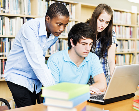 three students library laptop