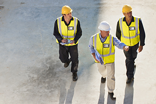 three construction workers walking job site
