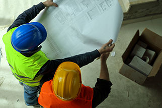 construction workers blueprints