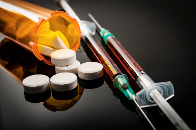 Opioid pills and syringes