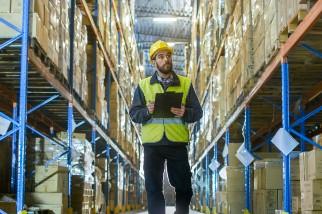Man in hard hat walking through warehouse