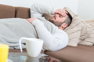 Man with flu resting on couch