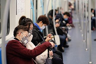 People wearing surgical mask sitting in subway in Shanghai