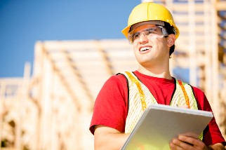 Supervisor inspecting work at building site