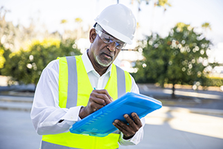 Black male manager inspecting a building project