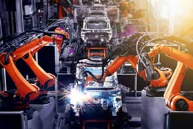 Robot arms working on an automobile production line