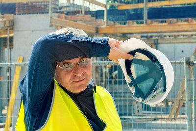 Man at work enduring heat stress
