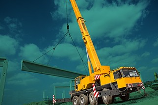 Construction equipment in front of a teal background