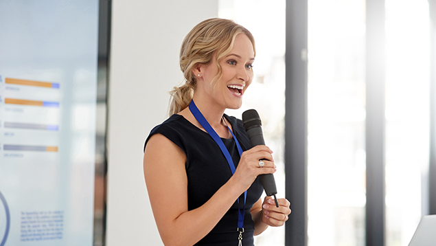 Young businesswoman delivering a presentation at a conference