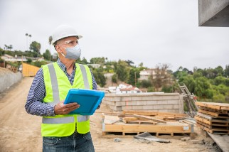 Construction manager with clipboard
