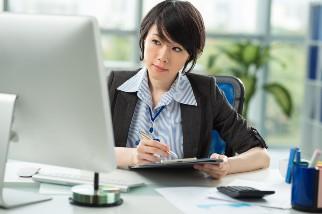 Businesswoman planning in her office