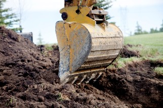 Backhoe digging a trench