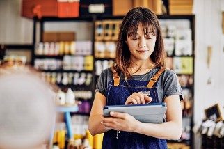 Young woman on a tablet at work