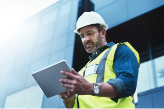 Engineer using a tablet on a construction site