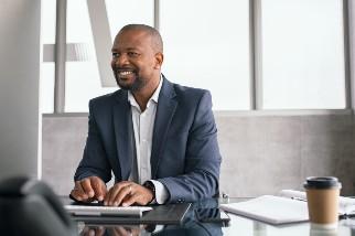 Smiling businessman at his desk