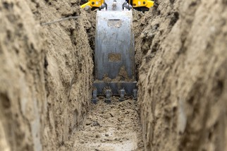 Digging a utility line trench