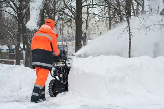 Person pushing a snowblower