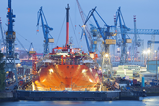 Ship maintenance in dry dock at night