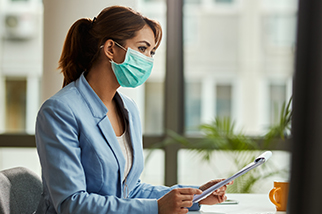 Young-female-safety-professional-wearing-cloth-face-mask-in-an-office
