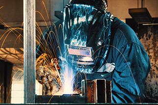 Worker-welding-two-metal-plates