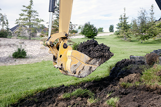 Backhoe-digging-a-trench