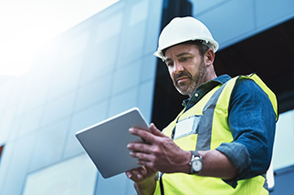 Male-engineer-using-a-digital-tablet-on-worksite