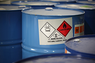 Chemical barrels with GHS labels in factory